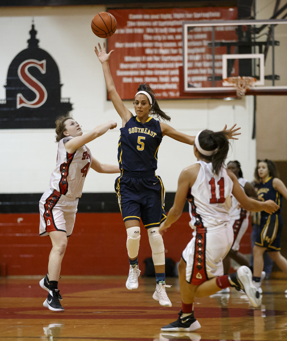 Southeast's Lunden Henry (5) steals a pass out of the air intended for Springfield's Abby Ratsch (40) in the first half at Springfield High School, Thursday, Dec. 10, 2015, in Springfield, Ill. Justin L. Fowler/The State Journal-Register