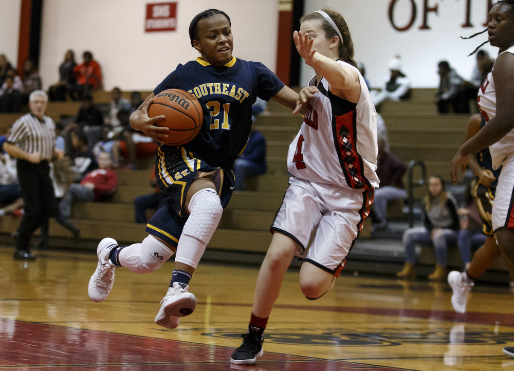 Southeast's Adriana Brown (21) drives to the basket against Springfield's Brooklyn Crum (4) in the first half at Springfield High School, Thursday, Dec. 10, 2015, in Springfield, Ill. Justin L. Fowler/The State Journal-Register
