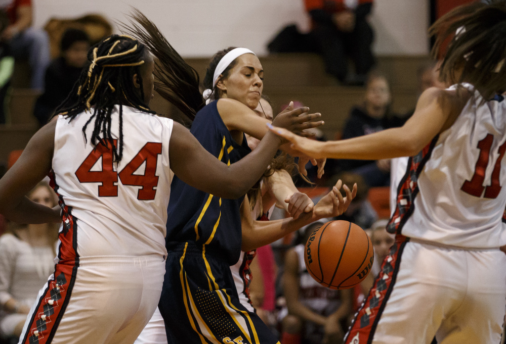 Southeast's Lunden Henry (5) has the ball knocked away from her by Springfield's Sarah Cross (22) in the first half at Springfield High School, Thursday, Dec. 10, 2015, in Springfield, Ill. Justin L. Fowler/The State Journal-Register