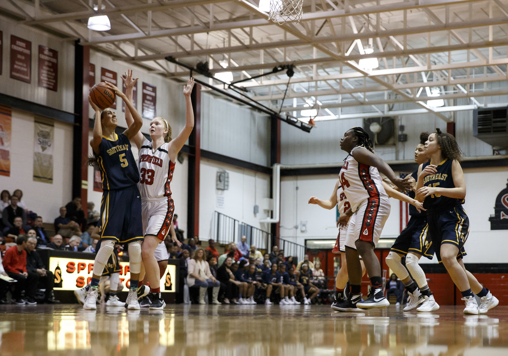 Southeast's Lunden Henry (5) goes up for a shot against Springfield's Ellie Brandt (33) in the first half at Springfield High School, Thursday, Dec. 10, 2015, in Springfield, Ill. Justin L. Fowler/The State Journal-Register