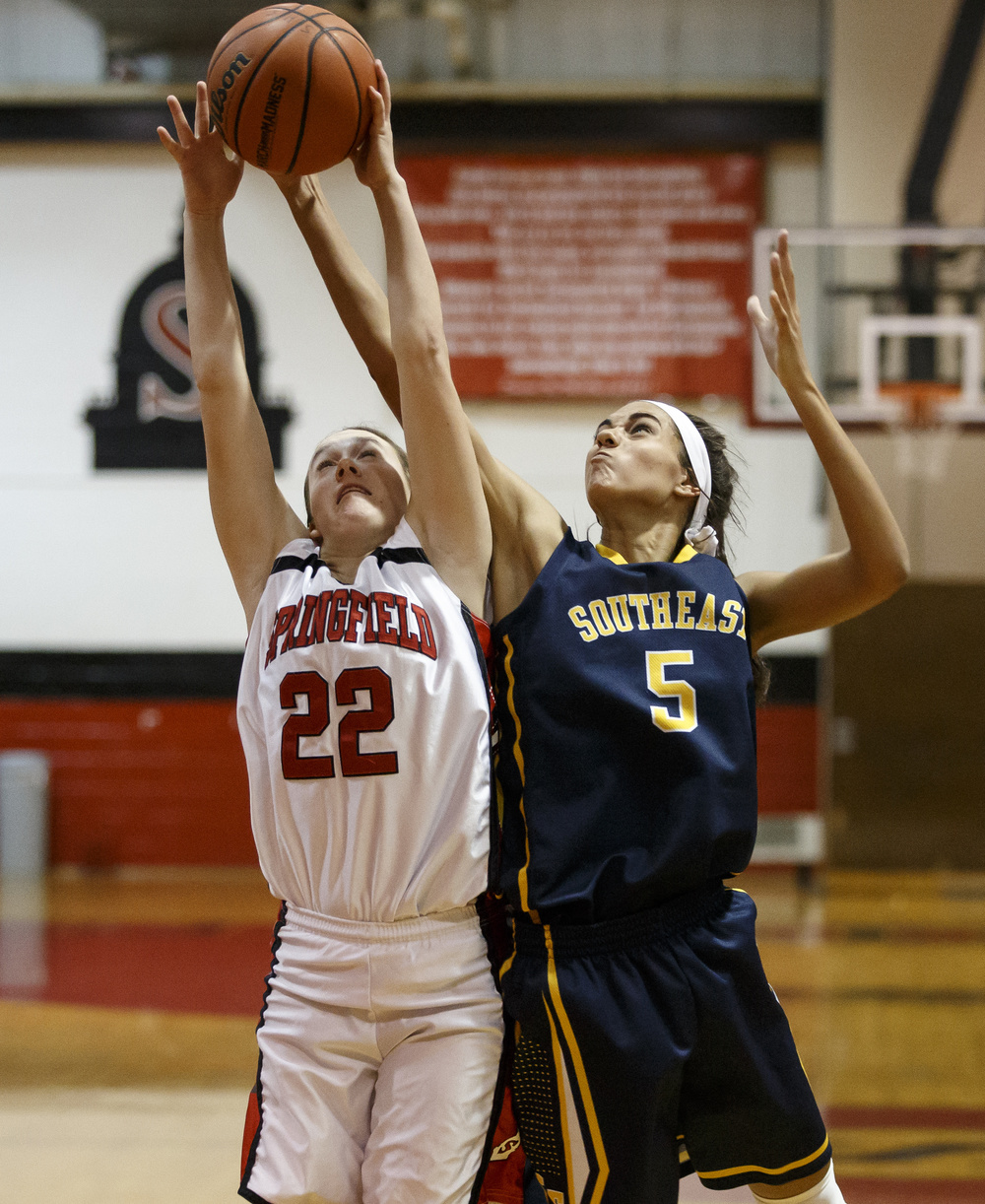 Springfield's Sarah Cross (22) goes for a rebound against Southeast's Lunden Henry (5) in the second half at Springfield High School, Thursday, Dec. 10, 2015, in Springfield, Ill. Justin L. Fowler/The State Journal-Register