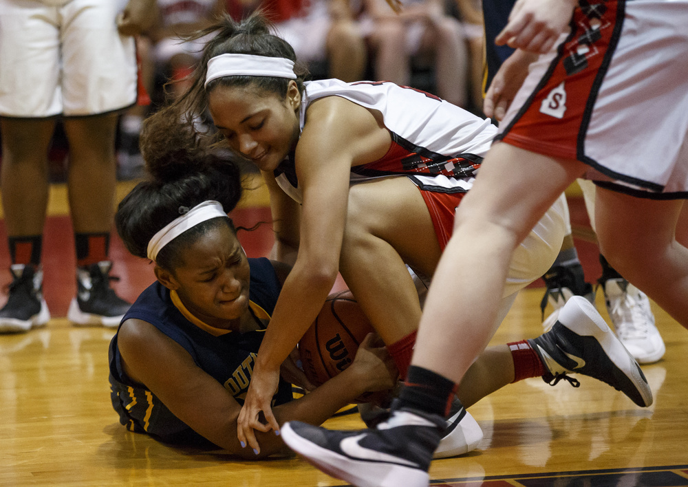 Springfield's Kyra Webster (11) and Southeast's Jadelyn King (32) battle for a loose ball in the second half at Springfield High School, Thursday, Dec. 10, 2015, in Springfield, Ill. Justin L. Fowler/The State Journal-Register
