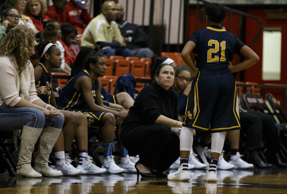 Southeast head coach Sandi Devoe talks with Southeast's Adriana Brown (21) along the bench as the Spartans shoot a set of free throws against Springfield in the second half at Springfield High School, Thursday, Dec. 10, 2015, in Springfield, Ill. Justin L. Fowler/The State Journal-Register