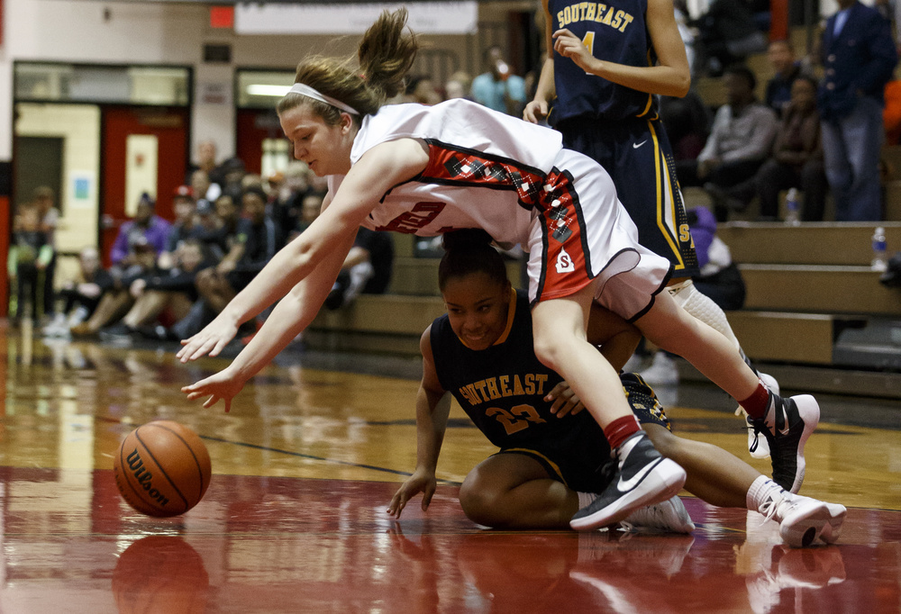 Springfield's Brooklyn Crum (4) collides with Southeast's Cydne Nichols (23) as she tries to dribble around the pressure late in the second half at Springfield High School, Thursday, Dec. 10, 2015, in Springfield, Ill. Justin L. Fowler/The State Journal-Register