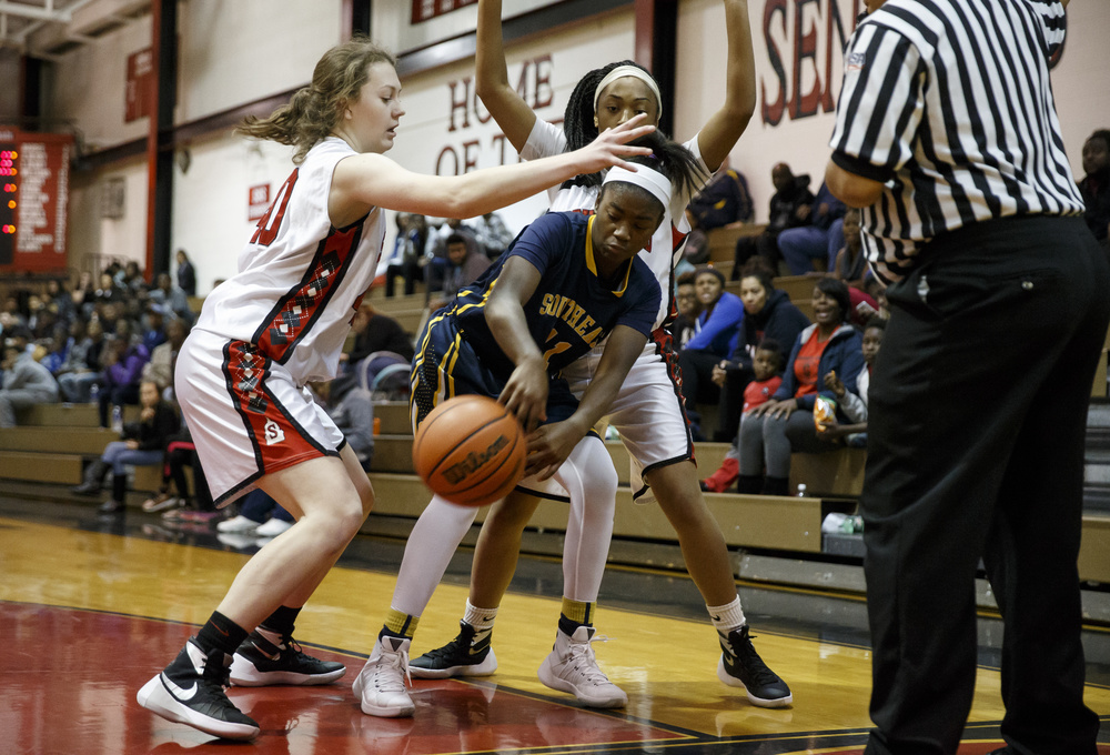 Southeast's Shelby Williams (11) tries to use a bounce pass out of the pressure from Springfield's Abby Ratsch (40) and Ta'Mya Dumas (13) in the second half at Springfield High School, Thursday, Dec. 10, 2015, in Springfield, Ill. Justin L. Fowler/The State Journal-Register