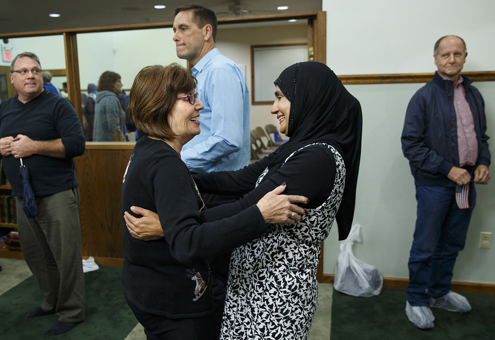 Patty Merano, left, greets Shabana Arshad after the Interfaith Peace Vigil sponsored by the Islamic Society of Greater Springfield at their masjid Sunday, Dec. 13, 2015. Merano came to the vigil with a group from the Chatham United Methodist Church. Ted Schurter/The State Journal-Register
