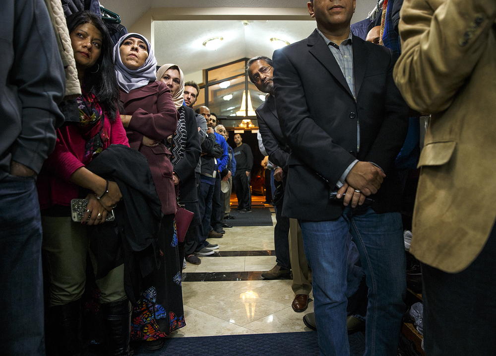 Guests at the Interfaith Peace Vigil sponsored by the Islamic Society at their masjid, line the hallway to the main prayer hall to hear the remarks Sunday, Dec. 13, 2015. About 250 people attended the event, filling the main hall and two overfow areas. Ted Schurter/The State Journal-Register