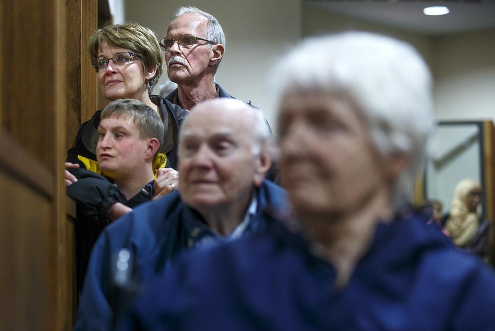 Judy Sunder, her husband Ted and son Nick watch the Interfaith Peace Vigil from an overflow room at the Islamic Society of Greater Springfield's masjid Sunday, Dec. 13, 2015. Ted Schurter/The State Journal-Register