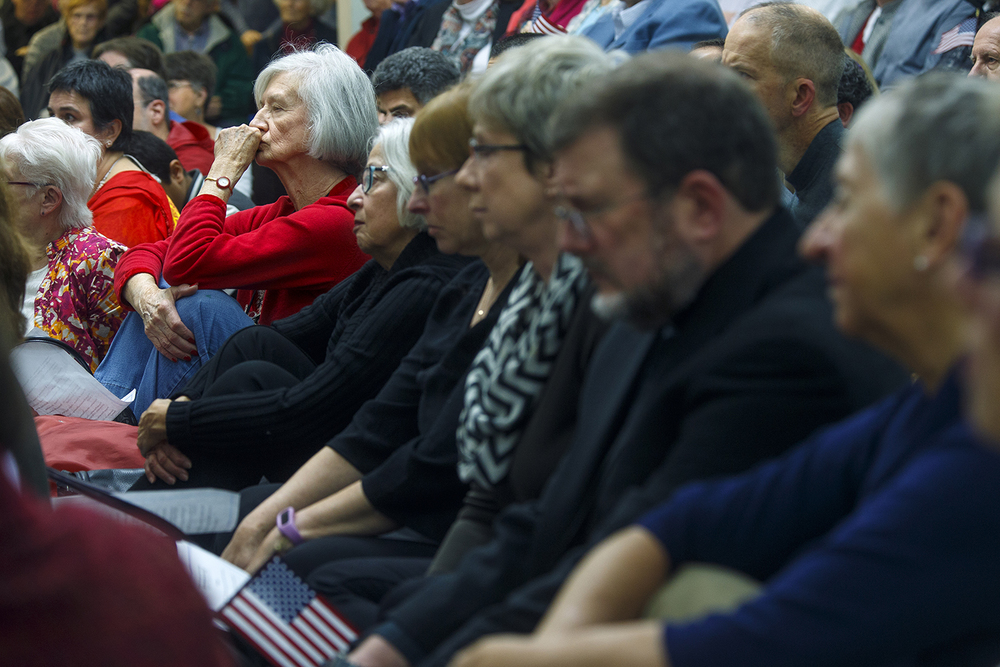 Guests watch the Interfaith Peace Vigil at the Islamic Society of Greater Springfield's masjid Sunday, Dec. 13, 2015. Ted Schurter/The State Journal-Register