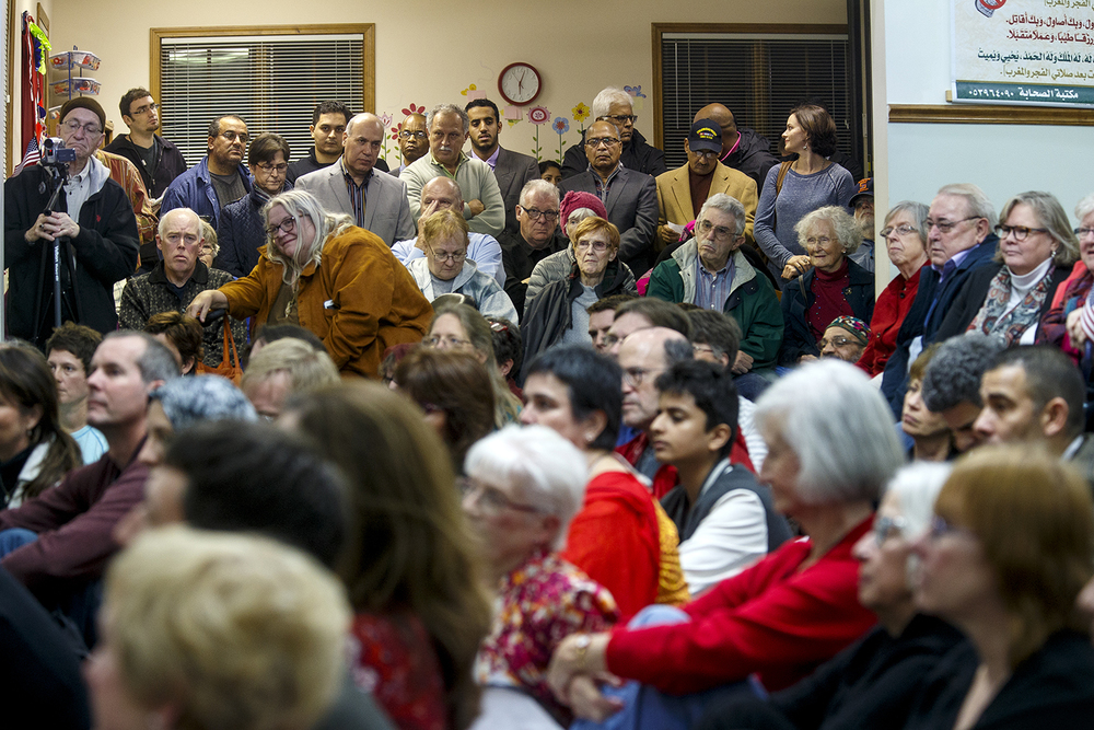 Guests watch the Interfaith Peace Vigil from an overflow room at the Islamic Society of Greater Springfield's masjid Sunday, Dec. 13, 2015. Ted Schurter/The State Journal-Register
