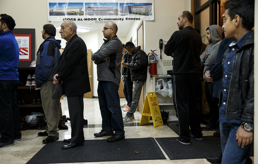 Guests line up all the way to the front door to watch the Interfaith Peace Vigil at the Islamic Society of Greater Springfield's masjid from an overflow room Sunday, Dec. 13, 2015. Ted Schurter/The State Journal-Register
