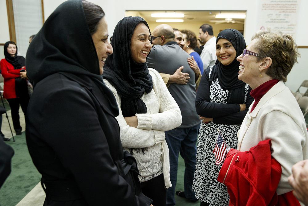 Ayesha Ahmad and her daughter Rahmah visit with Sherry Frachey after the Interfaith Peace Vigil at the Islamic Society of Greater Springfield's masjid Sunday, Dec. 13, 2015. Ted Schurter/The State Journal-Register