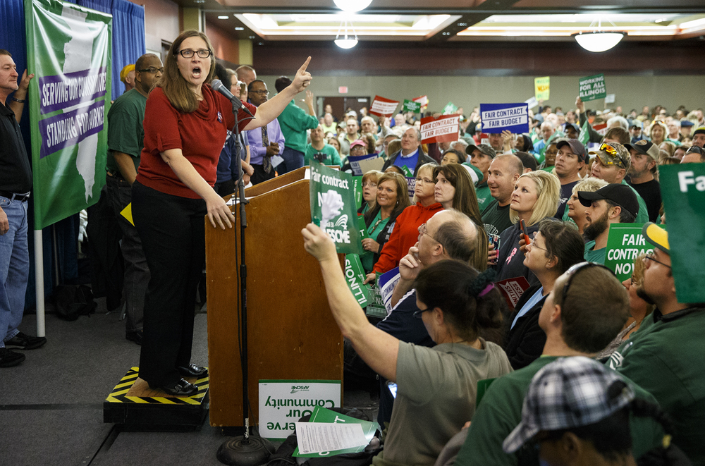 "Joanna Webb-Gauvin, legislative director for American Federation of State, County and Municipal Employees Council 31, addresses the crowd gathered for one of AFSCME's seven statewide ""Rallies for Fairness"" Thursday, Dec. 10, 2015. Ted Schurter/The State Journal-Register"
