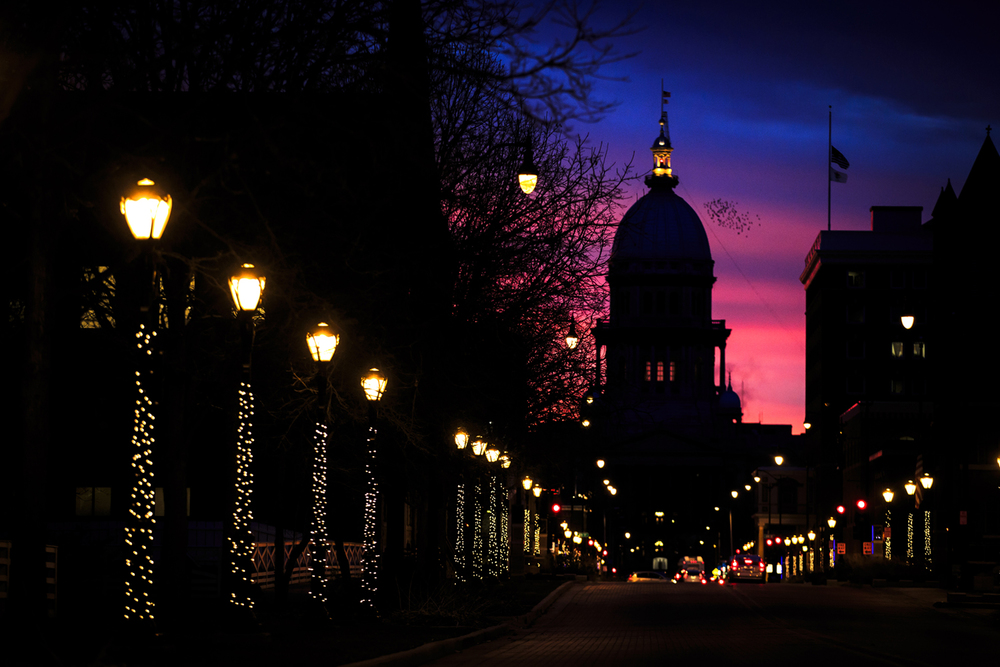 Street lights decorated for the holidays lead to the State Capitol and a stunning sunset behind it Wednesday, Dec. 9, 2015. Justin L. Fowler/The State Journal-Register