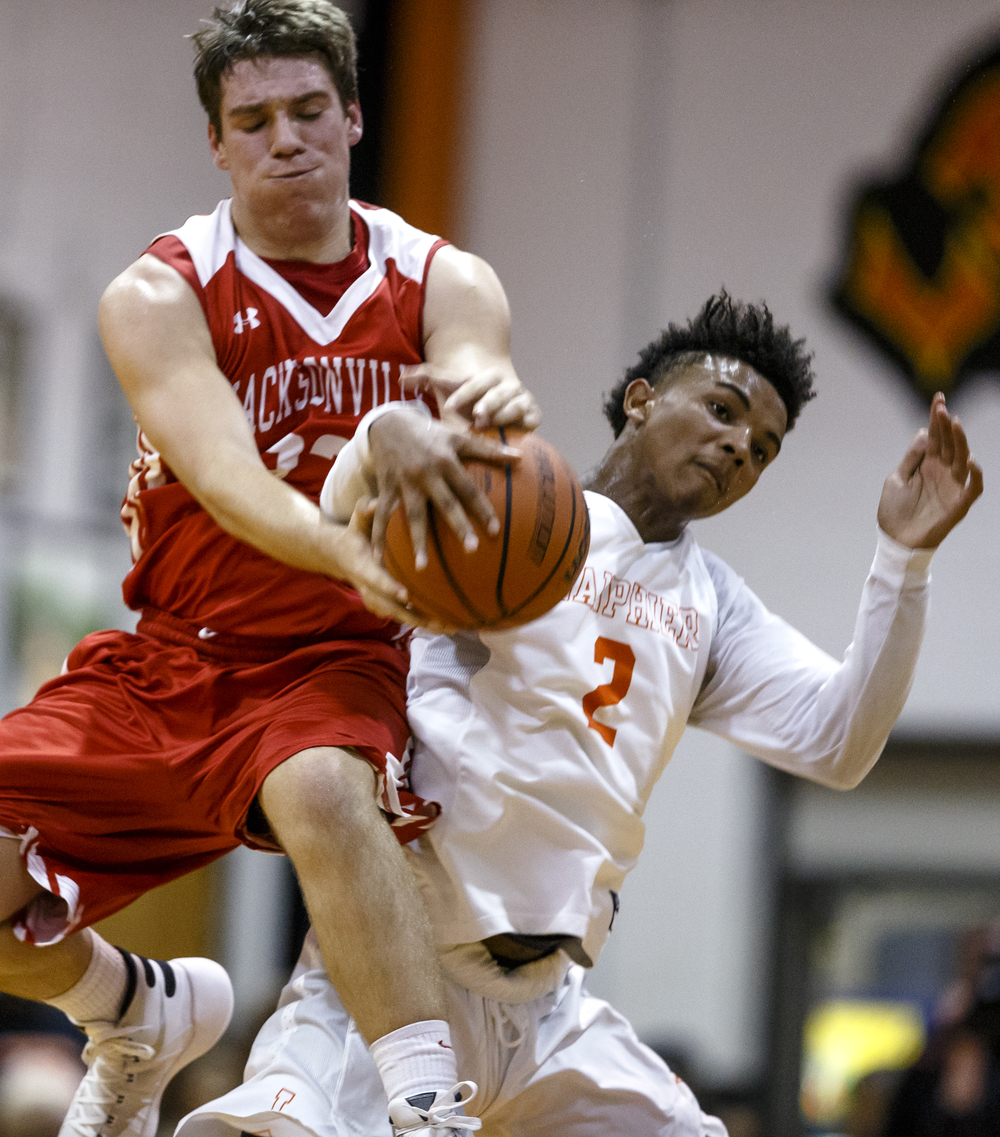 Lanphier's Cardell McGee (2) fouls Jacksonville's Joe Brannan (23) going for a steal in the air in the first half at Lober-Nika Gymnasium, Friday, Dec. 11, 2015, in Springfield, Ill. Justin L. Fowler/The State Journal-Register