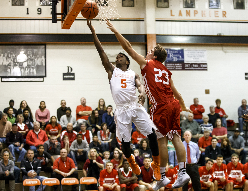 Lanphier's Xavier Bishop (5) lays in a basket on a fast break against Jacksonville's Joe Brannan (23) in the first half at Lober-Nika Gymnasium, Friday, Dec. 11, 2015, in Springfield, Ill. Justin L. Fowler/The State Journal-Register