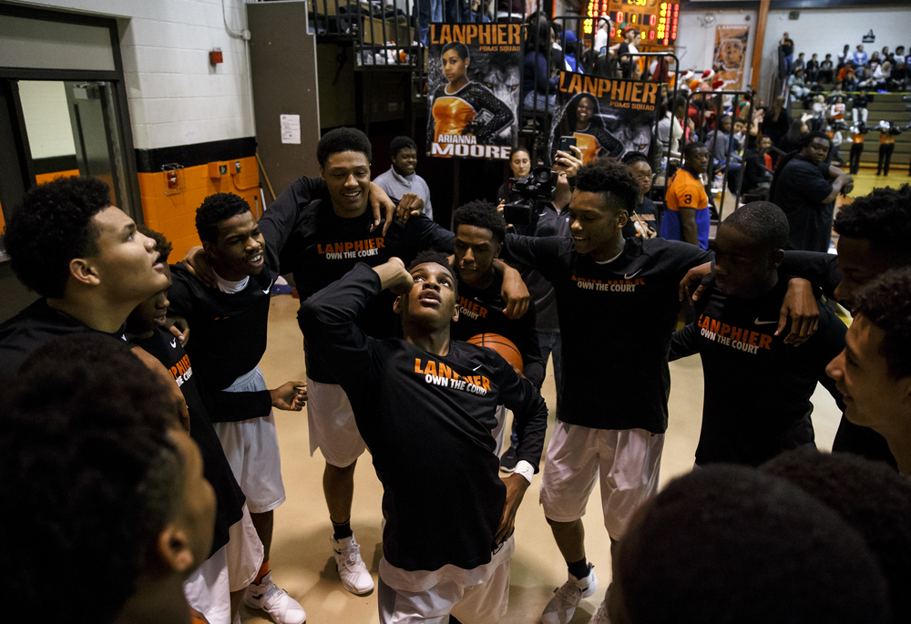 Lanphier's Aundrae Williams (23) is surrounded by his teammates as they preform their pre-game dance prior to taking on Jacksonville at Lober-Nika Gymnasium, Friday, Dec. 11, 2015, in Springfield, Ill. Justin L. Fowler/The State Journal-Register