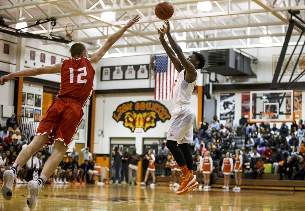 Lanphier's Xavier Bishop (5) fires a three against Jacksonville's Brandon McCombs (12) in the first half at Lober-Nika Gymnasium, Friday, Dec. 11, 2015, in Springfield, Ill. Justin L. Fowler/The State Journal-Register