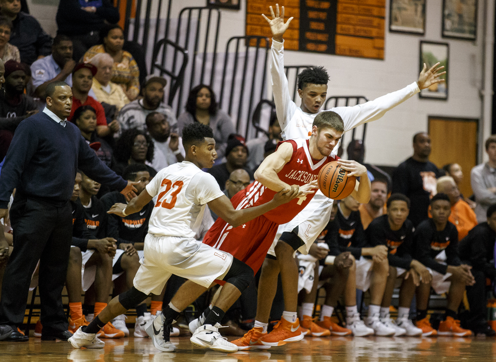 Lanphier's Dejiour Burns (44) is fouled by Lanphier's Aundrae Williams (23) as he tries to pass the ball away under pressure from the Lions in the first half at Lober-Nika Gymnasium, Friday, Dec. 11, 2015, in Springfield, Ill. Justin L. Fowler/The State Journal-Register