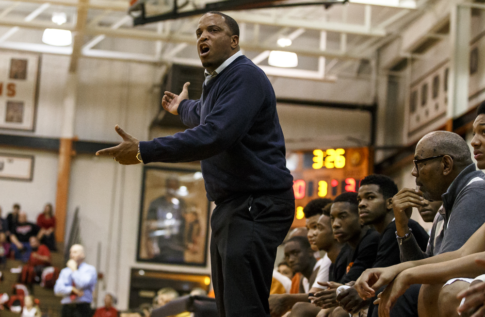 Lanphier head basketball coach Blake Turner asks the referees why a foul was called on his team as they take on Jacksonville in the second half at Lober-Nika Gymnasium, Friday, Dec. 11, 2015, in Springfield, Ill. Justin L. Fowler/The State Journal-Register