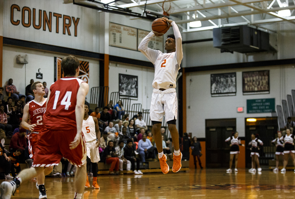 Lanphier's Cardell McGee (2) fires a jumper against Jacksonville in the second half at Lober-Nika Gymnasium, Friday, Dec. 11, 2015, in Springfield, Ill. Justin L. Fowler/The State Journal-Register