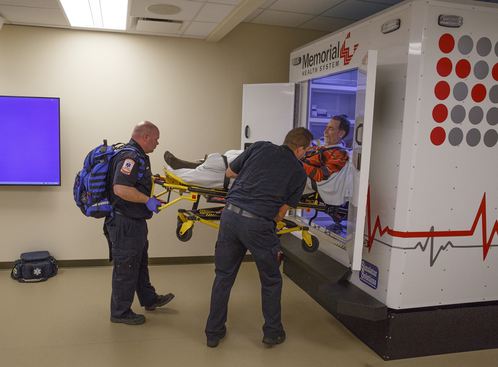 Jimmy Gerberding, left, and Kyle Enstrom, paramedics with the Chatham Fire Department, load patient actor John Petter into an ambulance simulator during a training session at the Center for Learning and Innovation at Memorial Medical Center Thursday, Dec. 17, 2015. The simulation began with Petter's call for help and followed it through his diagnoses and treatment. Rich Saal/The State Journal-Register