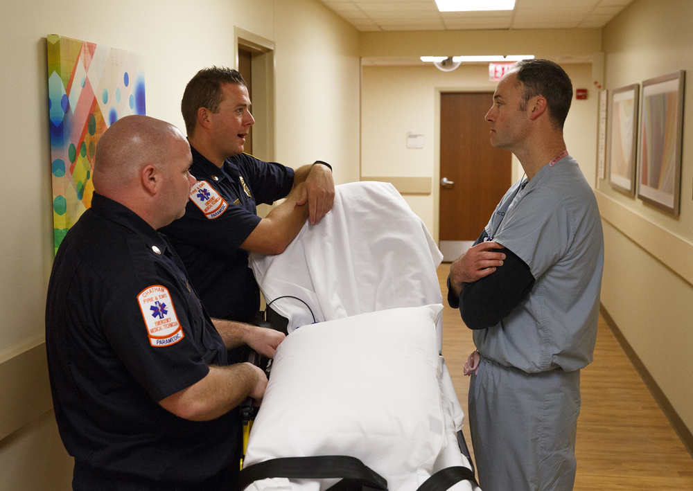 Chris McDowell, emergency medical physician at Southern Illinois University School of Medicine, talks with Jimmy Gerberding, left, and Kyle Enstrom from the Chatham Fire Department, during a training simulation at the Center for Learning and Innovation at Memorial Medical Center Thursday, Dec. 17, 2015. Rich Saal/The State Journal-Register