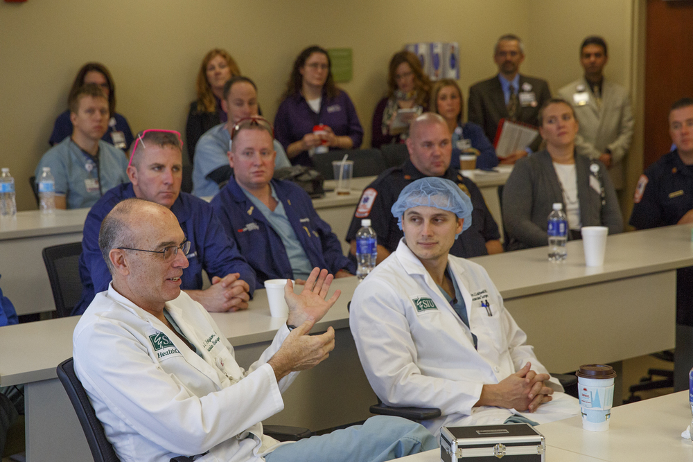 Dr. Kim Hodgson, professor and chair of the vascular surgery department at Southern Illinois University School of Medicine, participates in a discussion following a training simulation at the Center for Learning and Innovation at Memorial Medical Center Thursday, Dec. 17, 2015. The simulation followed a patient's initial contact with emergency medical responders through his diagnoses and treatment. Rich Saal/The State Journal-Register