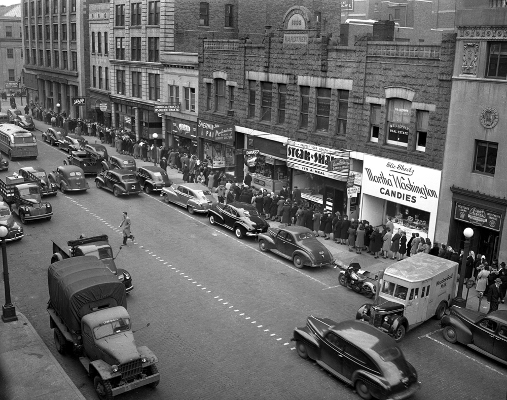 The line to redeem Christmas savings books in December 1946 stretched from the Security Federal Savings and Loan at 518 E. Monroe St. to the ends of the block in each direction. File/The State Journal-Register