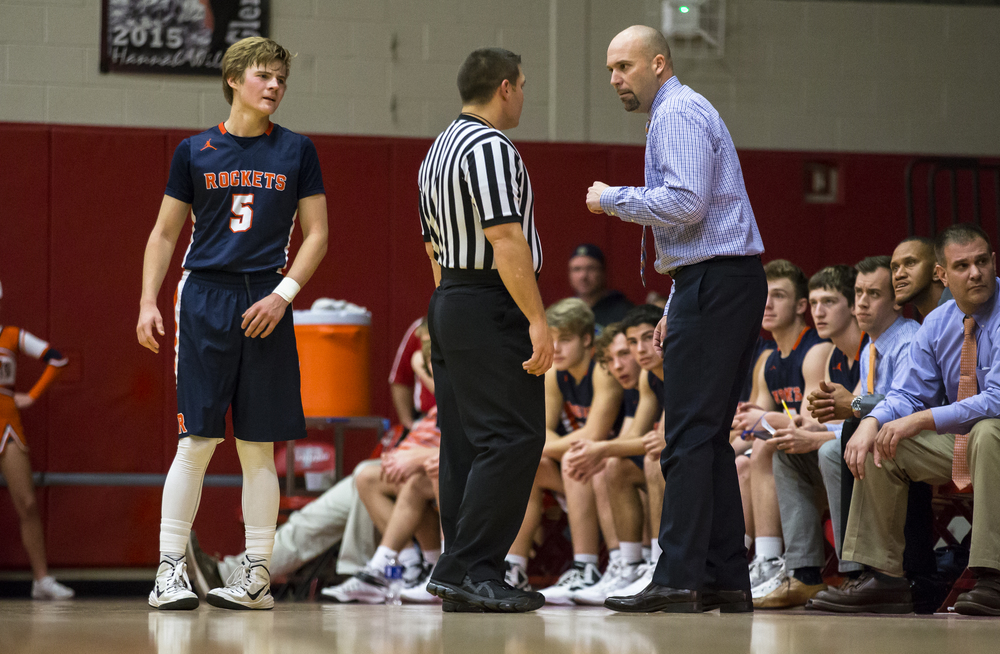 Rochester boys basketball head coach Mike Steers and Rochester's Dalton Handlin (5) talk with a referee after a technical foul was called on Rochester in the second half at Glenwood High School, Friday, Dec. 18, 2015, in Chatham, Ill. Justin L. Fowler/The State Journal-Register