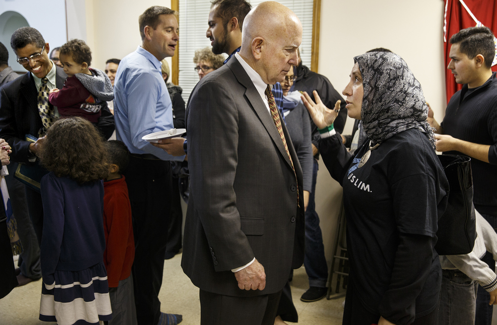 Rasha Alahdab talks with Jim Lewis, U.S. Attorney General for Central District of Illinois, after the Interfaith Peace Vigil sponsored by the Islamic Society of Greater Springfield at their masjid Sunday, Dec. 13, 2015. Alahdab is a founding partner of Syrian Women for Syria, and a founding board member of Syrian Expatriates for Democracy. Ted Schurter/The State Journal-Register