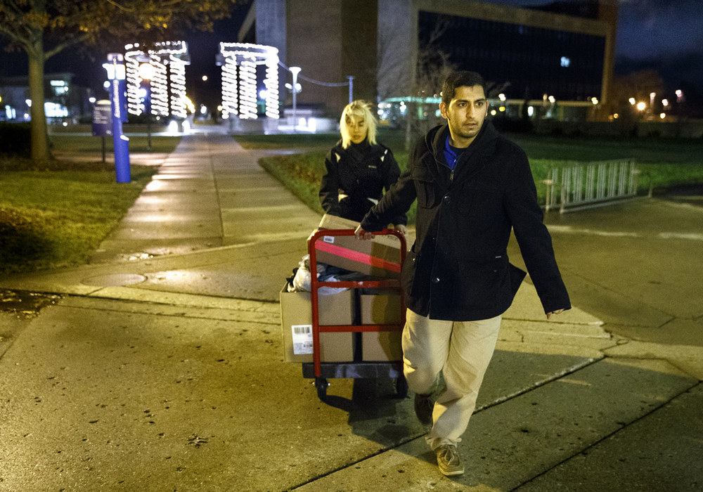 Asad Sohail and Maricela Arce transport donations they've gathered from drop boxes for the Clothes Drive for Syrian Refugees at the University of Illinois Springfield to the Diversity Center Monday, Dec. 14, 2015. The donated items will be delivered to the Rahma Relief Foundation for distribution overseas. Ted Schurter/The State Journal-Register