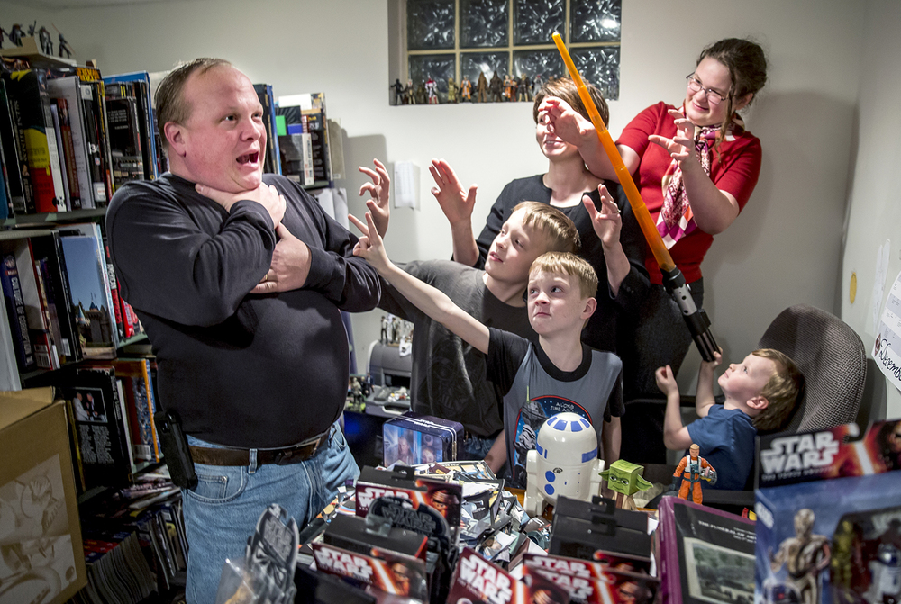 "The Force is strong with Joe Kessler, left, and his family, including his wife, Betty, daughter, Mary Beth, and three sons, Joey, 10, John Paul, 7, and Luke, 2, named after Luke the Evangelist and Luke Skywalker, as the family looks forward to the release of the newest film in the series, ""Star Wars: The Force Awakens."" Justin L. Fowler/The State Journal-Register"