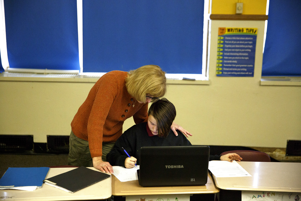 Rhea Drake, a special education resource teacher, works with Laci Gaines on her math problems Monday, Dec. 14, 2015 at 8 Points Charter School in Jacksonville.The Jacksonville school board votes tomorrow (Note: refers to Wednesday, Dec. 16) on whether 8 Points' five-year contract should be renewed or terminated. Rich Saal/The State Journal-Register