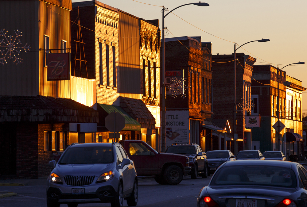 The setting sun casts the State Street storefronts in Nokomis in a firery tone Friday, Dec. 18, 2015. Rich Saal/The Starte Journal-Register