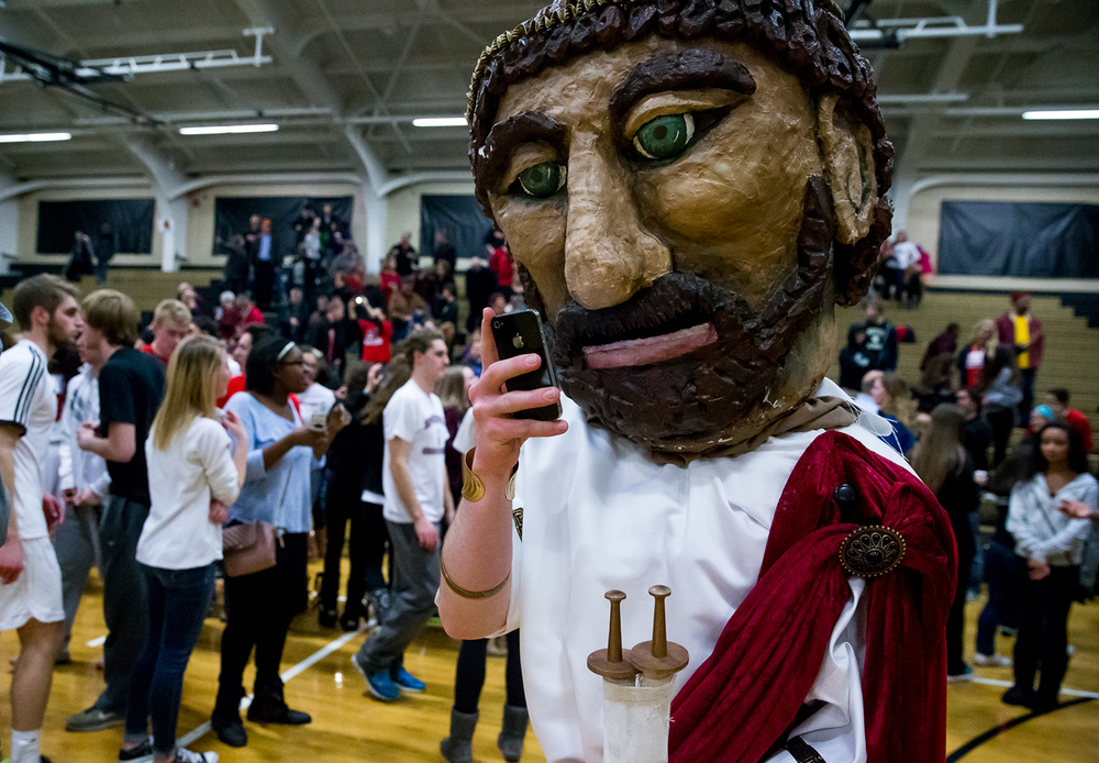 Solon, the Springfield High mascot, sends out a text after Springfield defeated Sacred Heart-Griffin in the 2015 Girls City Tournament at Jim Belz Gymnasium, Thursday, Jan. 29, 2015, in Springfield, Ill. Justin L. Fowler/The State Journal-Register