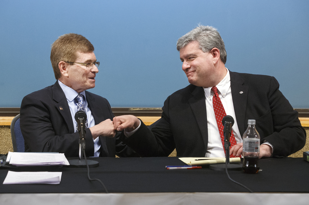 Springfield mayoral candidates Jim Langfelder, left, and Paul Palazollo fist bump at the conclusion of their debate at The State Journal-Register Monday, March 23, 2015.  Ted Schurter/The State Journal-Register