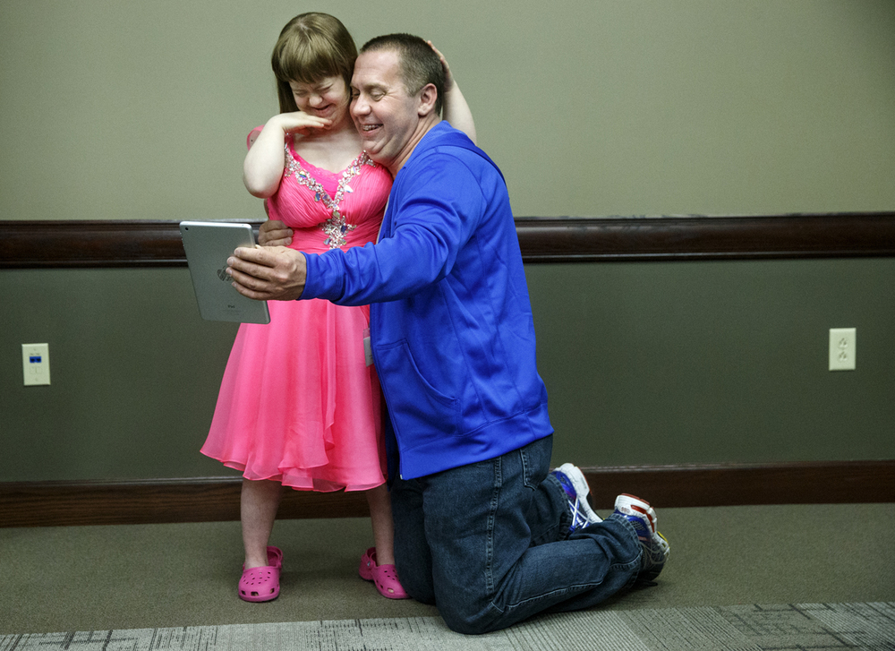 "Craig Quasny poses with his daughter Gabby as they take a photo after the The Hope Institute's 10th Annual ""Style of Hope"" at the Prairie Capital Convention Center Thursday, March 19, 2015. The event raises funds to benefit the children of The Hope Institute.  Ted Schurter/The State Journal-Register"