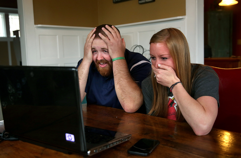Joel Burger and Ashley King react after learning via SKYPE  from a New York public relations firm that Burger King would be paying for their July wedding at the home of Ashley King's parents in New Berlin on Monday afternoon, April 6, 2015. New Berlin residents Joel Burger and Ashley King, who have known each other since kindergarten, are planning a July wedding in Jacksonville folks are calling the Burger-King wedding.  David Spencer/The State Journal-Register