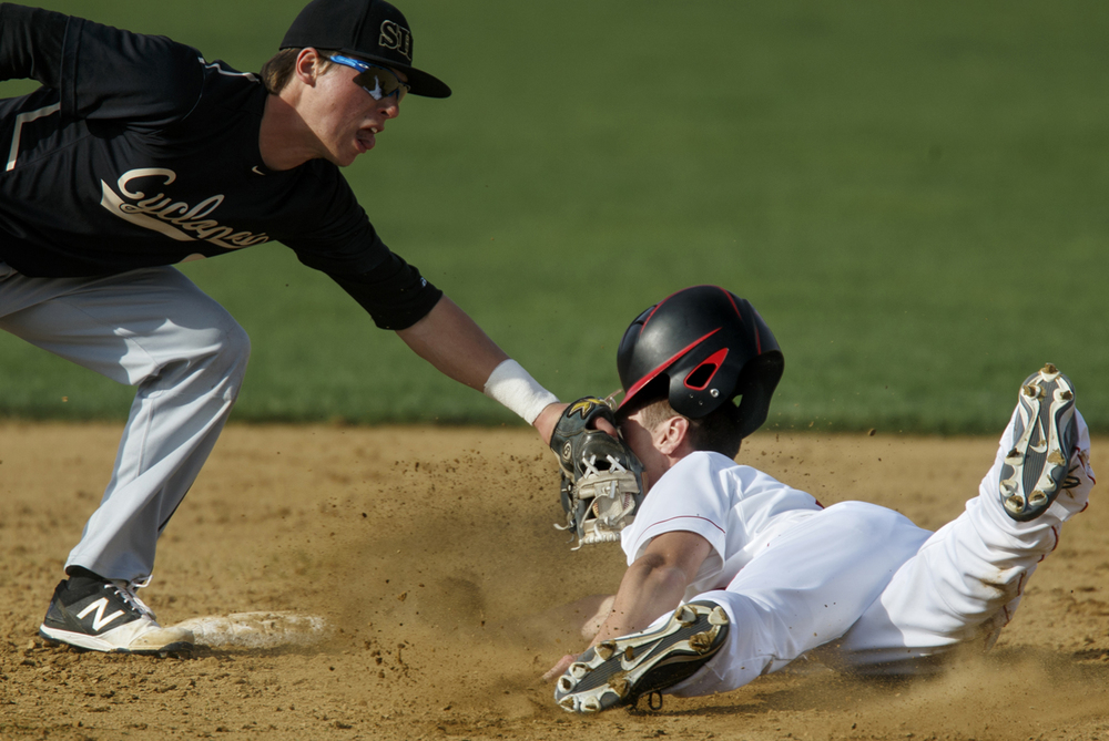 Sacred Heart-Griffin's Cole Daily tags Chatham Glenwood pinch runner Austin Fitzgerald in the face at second base Tuesday, April 7, 2015. Ted Schurter/The State Journal-Register
