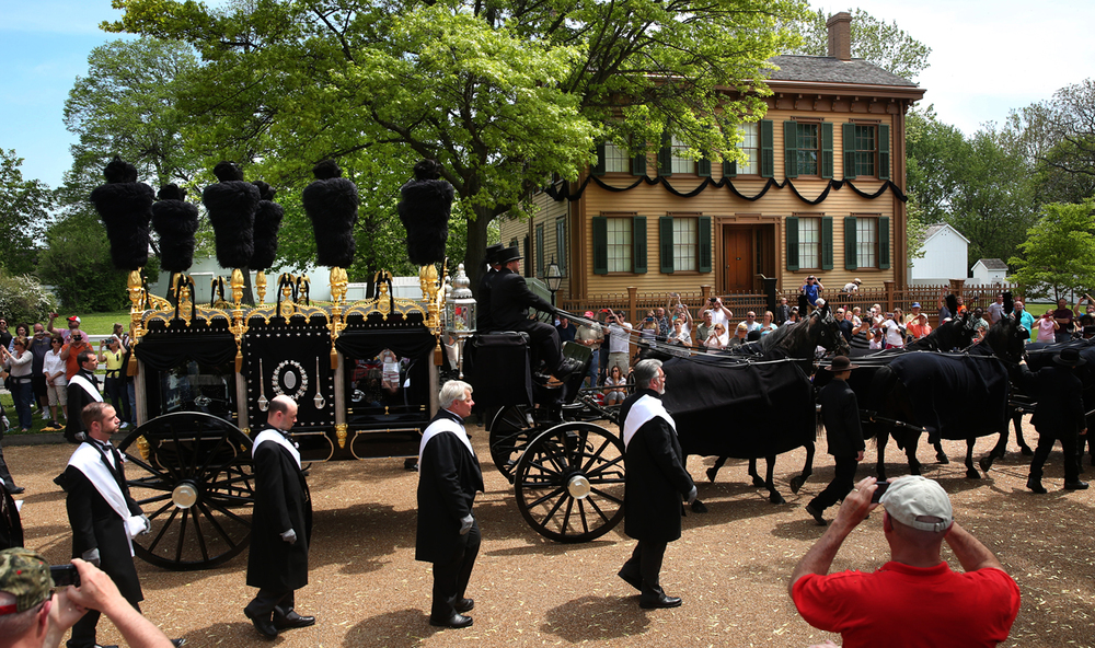 Lincoln's hearse passes by the Lincoln Home on Sunday afternoon. The final procession as part of the 150th anniversary of 