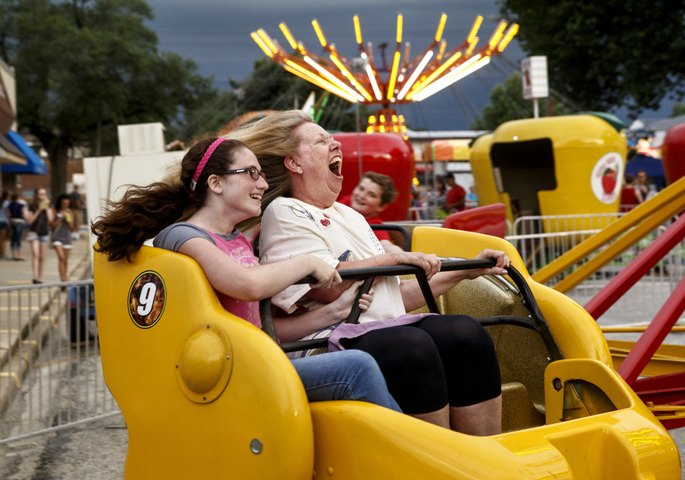Kathy Roseberry screams as she rides the Sizzler with her granddaughter Emily Roseberry at Pawnee Prairie Days Thursday, June 25, 2015. Kathy said it had been it had been 25 years since she last climbed onto a carnival ride and, after that one, it will be at least another 20 before she rides again. Prairie Days is open through Saturday evening. Ted Schurter/The State Journal-Register