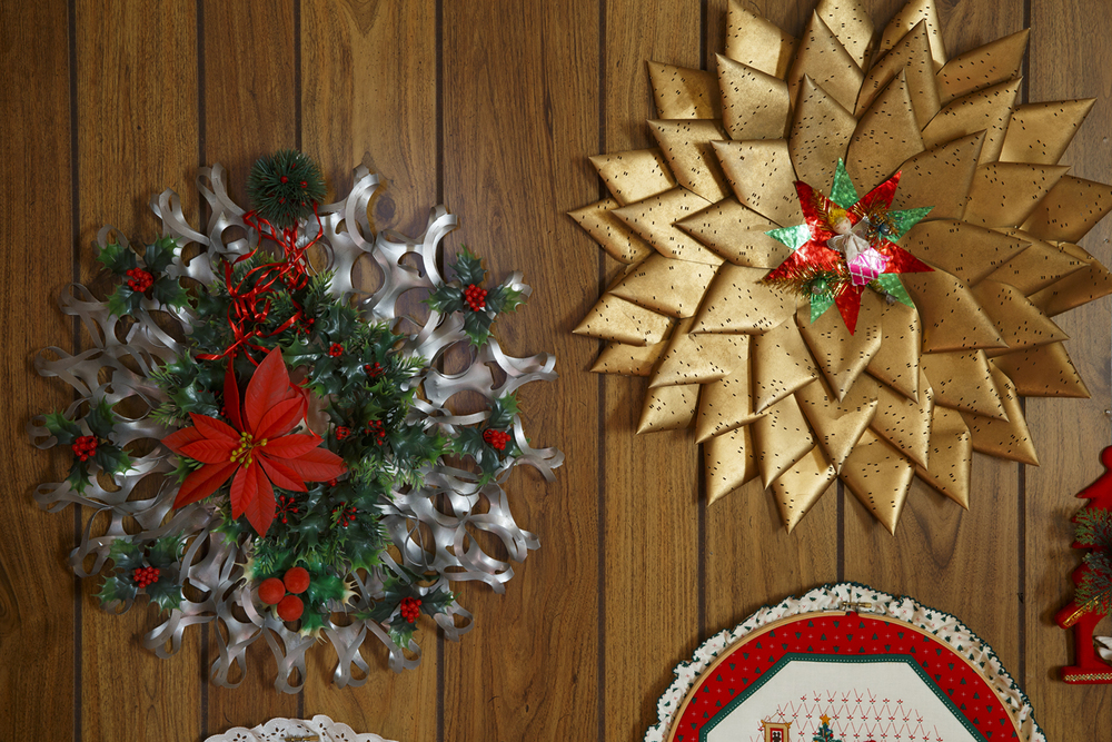 Jean Hulbert's Christmas decoration collection includes a wreath made from plastic six-pack rings, left, and one from IBM computer punch cards.