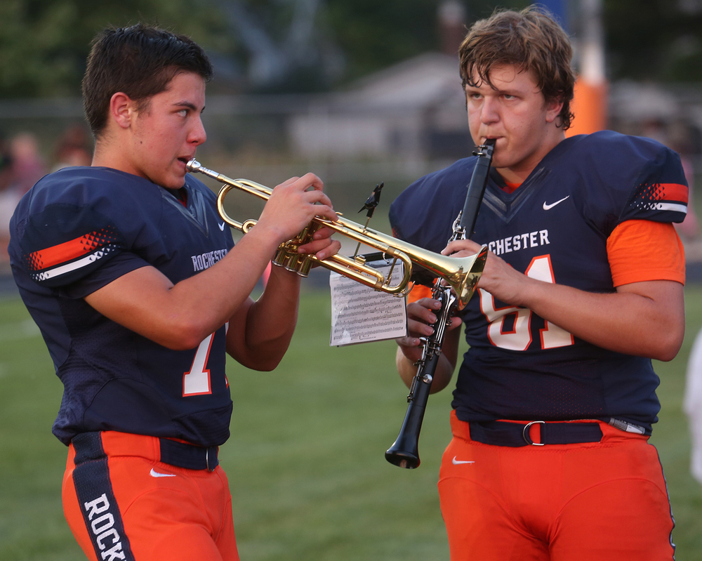 Rockets football team members who also play in the band practice before joining in before the game. Matthew Tungett plays trumpet and Kross Arnold plays the clarinet. The Rochester High School Rockets defeated the Springfield High School Senators 53-15 in football action at Rocket Stadium on Friday evening, Sept. 4, 2015. David Spencer/The State Journal-Register