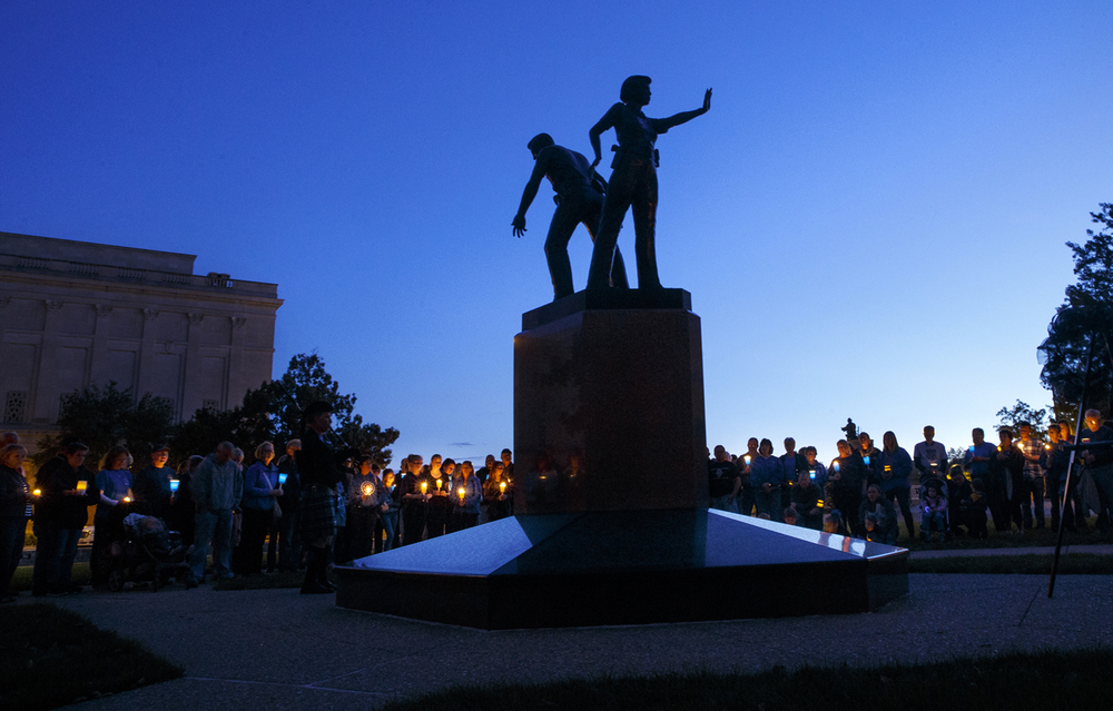 About 200 people joined in a candlelight vigil around the Illinois Police Officers Memorial Saturday, Sept. 12, 2015. Event organizers created the event in honor of slain Harris County Texas Deputy Darren Goforth and all of the other men and women who work in law enforcement.  Ted Schurter/The State Journal-Register