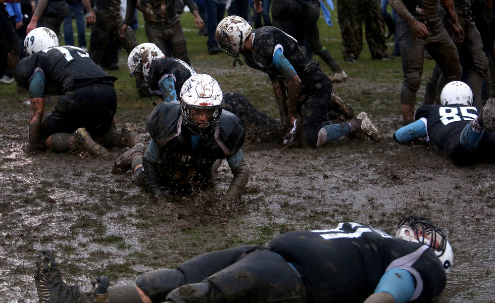 North Mac players made it a mudbowl during their victory slide in the middle of the field at the end of the game. North Mac defeated Pleasant Plains 27-20 at Bruna Athletic Field in Virden to win the Class 3A football playoff game on Saturday, Oct. 31, 2015. David Spencer/The State Journal-Register