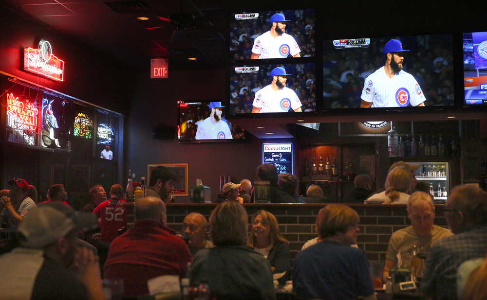 Chicago pitcher Jake Arrieta is seen on multiple screens during the game inside the Corner Pub & Grill Monday night. Baseball fans at Springfield's Corner Pub & Grill on W. Iles Ave. watched the Chicago Cubs host the St. Louis Cardinals in game 3 of the National League Division Series at Wrigley Field in Chicago on Monday evening, Oct. 12, 2015. Starting pitchers were Jake Arrieta for the Cubs and Michael Wacha for the Cards. David Spencer/The State Journal-Register