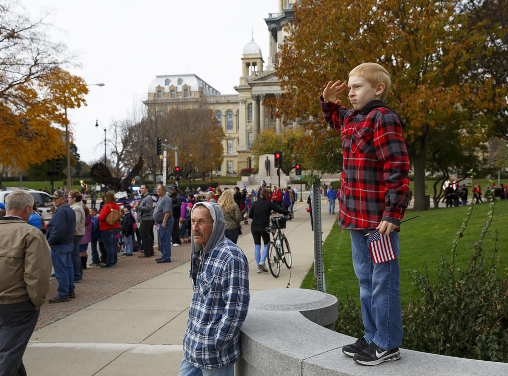 Dalton Anders, 13, salutes as the colors pass during the Veterans Day parade on Capitol Avenue in Springfield, Wednesday, Nov. 11, 2015. Rich Saal/The State Journal-Register