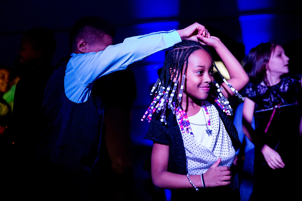 Nevaeh Macon, 7, gets spun around by her dance partner, Jericho Burnes 11, during the Grand Ball at Dubois Elementary School, Friday, Jan. 30, 2015, in Springfield, Ill. Justin L. Fowler/The State Journal-Register