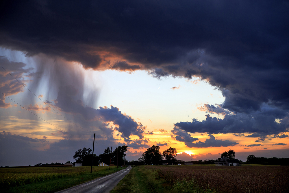 The remnants of an earlier storms release a small shower as they move across Werner Road looking west as the sun begins to set and cooler temperatures arrive, Thursday, Sept. 10, 2015, near Curran, Ill. Justin L. Fowler/The State Journal-Register